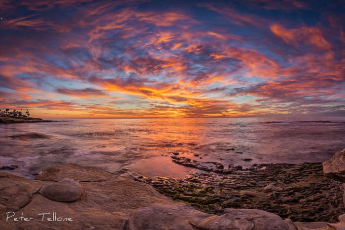 Photo of The clouds swirling around a center at sunset on Wipeout Beach in La Jolla California Fine Art print