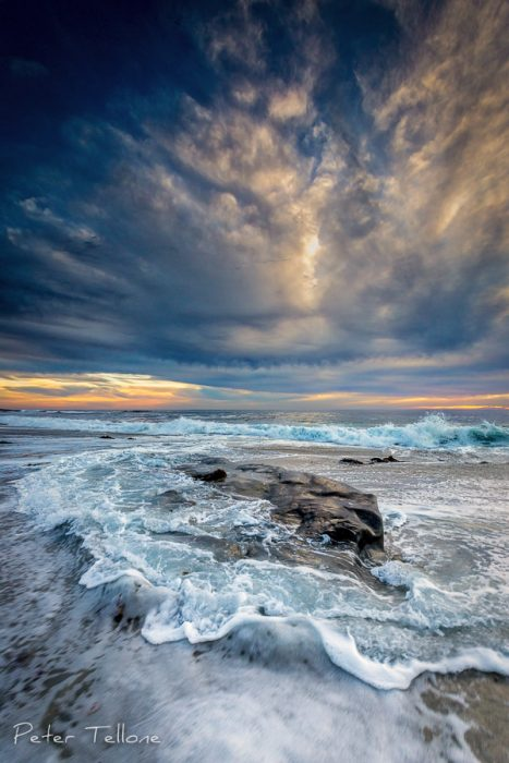 Photo of Shapes formed in the clouds over the swirling surf amongst the rocks at Windansea Beach, La Jolla, California fine art print
